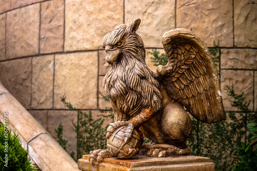 Fotografiet statue of Griffin or griffon a legendary creature with the body of a lion, the h