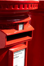 Red Cast Iron Pillar Boxes With SAT Plate Denoting The Next Collection Day Being Saturday