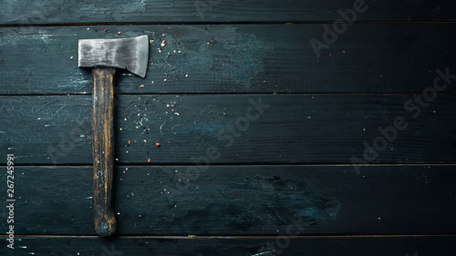 Photo Stands Firewood texture Ax on a black background. Free space for your text. Rustic style.