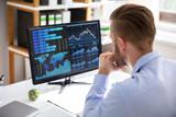 Businessman Analyzing Graph On Computer