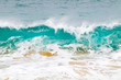 canvas print picture - Blue and aquamarine color sea waves and yellow sand  with white foam. Marine beach background.