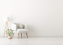 Living Room Interior Wall Mockup With Gray Velvet Armchair, Round Pillow With Tropical Pattern, Standing Lamp And Plant In Basket On Empty White Wall Background. 3D Rendering, Illustration.