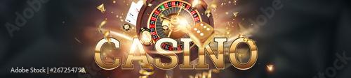 Valokuvatapetti Creative background, inscription casino, roulette, gambling dice, cards, casino chips on a dark background
