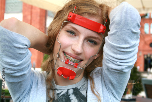 Happy Girls with Braces and Orthodontic Headgear Facemask Wallpaper Mural