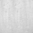 Betonwand im Quadratformat 1:1. Weißgraue Struktur. Raue Betonwand mit rauen Mustern und Abnutzungsspuren. Struktuierte Steinwand im Industrial Design.