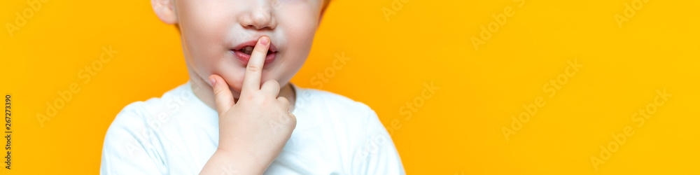 Fototapety, obrazy: little boy child put his finger on lips, keep silence serious, blonde hair