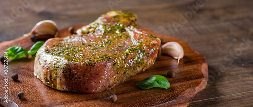 Raw Pork Loin chops marinated meat Steak for bbq on wooden table background Wallpaper Mural