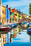 Colorful houses on the canal in Burano island, Venice, Italy.