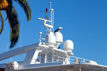 Top Deck Of Luxury Modern Yacht With Navigational Equipment, Under Palm Tree .