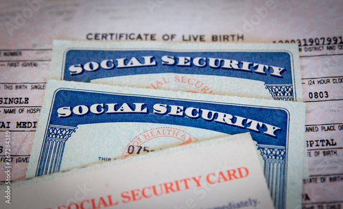 wo USA Social Security cards with number obscured surrounded