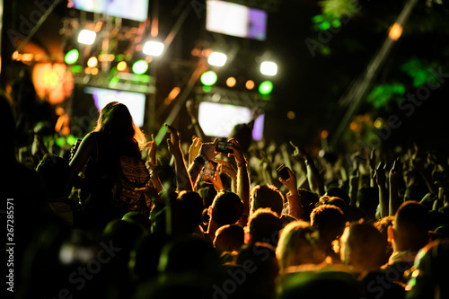 Rear view of crowd with smart phones having fun on music festival. - 267285571