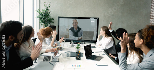 Business team having video call with senior boss at office - 267286552
