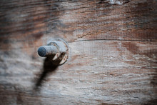 Rusty Screw In Vintage Wood Closeup - Construction Concept Background