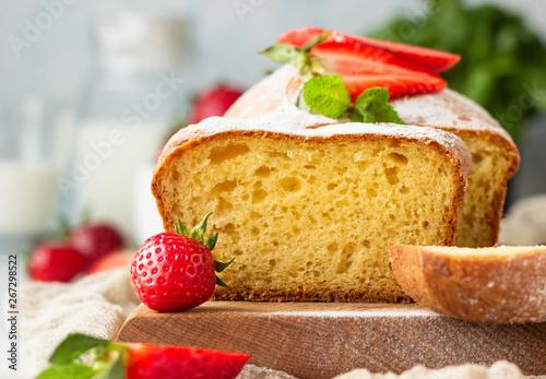 Obraz na plátně Pound or loaf cake with strawberry and mint on wooden board