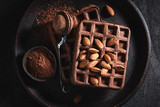 Homemade waffles made of cocoa with almonds