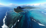 Aerial view of Tropical island in deep blue ocean, clear water, le Morne underwater waterfall at Mauritius