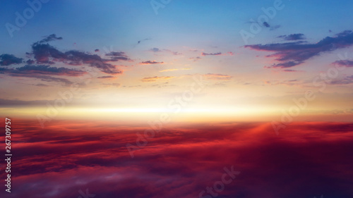 Beautiful sunset . Beautiful heavenly landscape with the sun in the clouds . View of clouds from high altitude . Paradise heaven .light about the sky .