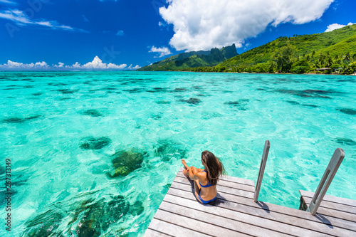Bora bora luxury travel overwater bungalow resort vacation bikini woman at Tahiti hotel Wallpaper Mural