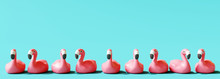 Flamingo Rubber On Pastel Blue Background. Summer Concept. 3d Rendering