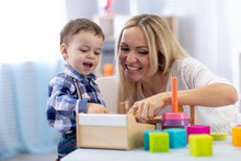 Cute Child And Mother Playing With Toys At Home. Little Toddler Boy Having Fun Pastime In Nursery.