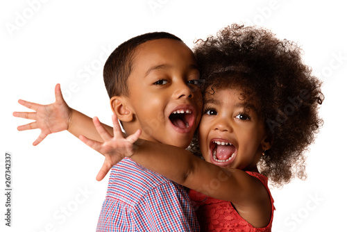 Tableau sur Toile Two cheerful african-american siblings, sister hugging her brother, isolated
