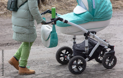 mata magnetyczna Girl with a stroller goes on the road in winter