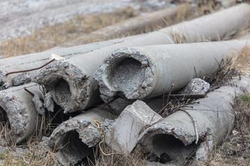 Broken concrete pillars lie on the ground