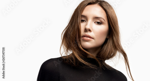 Fotografiet  Close-up portrait of beautiful girl with perfect skin wearing black pullover