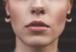 Leinwandbild Motiv Close up of young woman with nose piercings