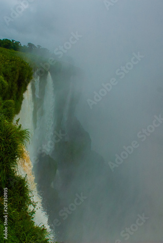 Foto op Aluminium Oranje All flows that converge into Devil's Throat at Iguazu Falls. Argentina