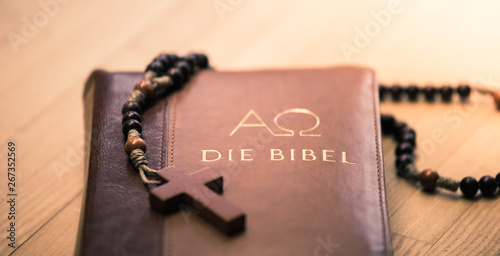 Holy bible and rosary: Christian bible and rosary on a wooden desk