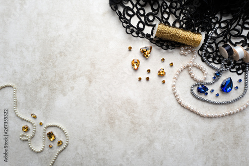 Materials and components for beadwork on a craft paper background Canvas Print