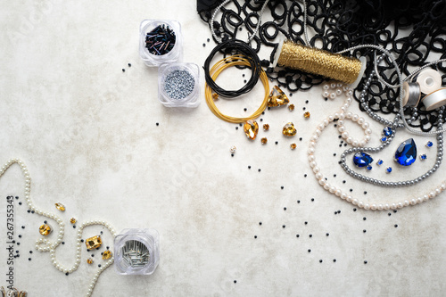 Materials and components for beadwork on a craft paper background Wallpaper Mural