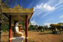 Lumbini Garden, Hpa An, Myanmar: View On Secluded Isolated Valley With Over 1000 Sitting Buddha Statues In Rows Contrasting With Blue Sky And Drifting Cirrus Clouds