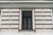 Window With Bars In An Old Bui...