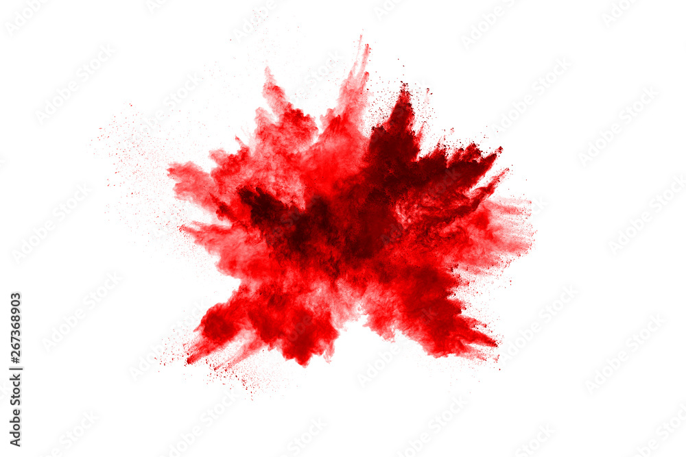 Fototapeta Freeze motion of red powder exploding, isolated on white background. Abstract design of red dust cloud. Particles explosion screen saver, wallpaper