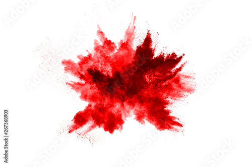 Fotografia, Obraz Freeze motion of red powder exploding, isolated on white background