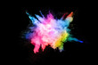 Leinwandbild Motiv abstract colored dust explosion on a black background.abstract powder splatted background,Freeze motion of color powder exploding/throwing color powder, multicolored glitter texture.