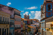Leinwanddruck Bild Historic city center of Pelourinho features brightly lit skyline of colonial architecture on a broad cobblestone hill in Salvador, Brazil