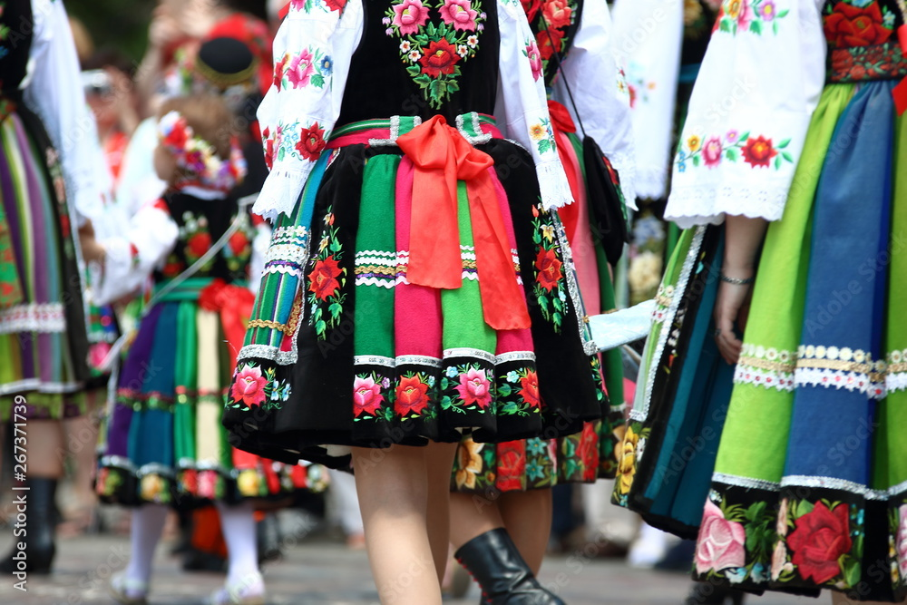 Fototapety, obrazy: Women, girls and kids in traditional folk costumes from Lowicz region in Poland walk during annual Corpus Christi procession