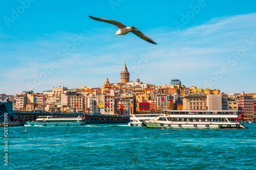 Poster de jardin Europe Méditérranéenne Galata Tower in istanbul City of Turkey. View of the Istanbul City of Turkey with bosphorus, seagulls and boats.