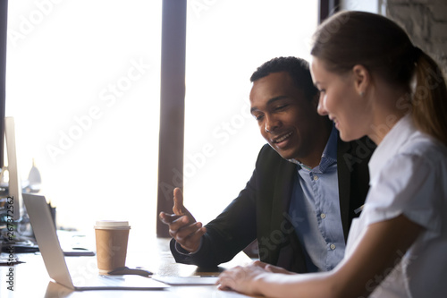 Photographie  Diverse female male coworkers sitting at desk brainstorming together