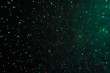 Star scattering of bright green and blue lights of fireworks during Halloween, Christmas, Independence Day, New Year.