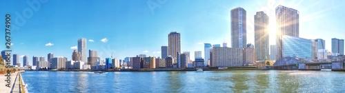 Fototapeta  Panoramic view of winter Sumida river under blue sky in Tokyo wi