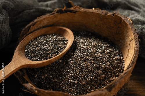Obraz chia seeds in dishes on wooden background - fototapety do salonu