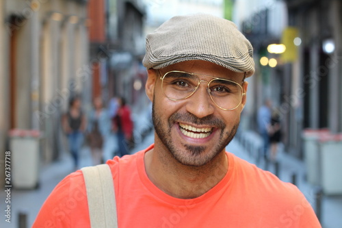 Photographie  Retro styled ethnic man smiling outdoors