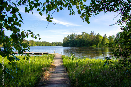 Summer view to the river Mustio and wooden walkway from the Mustion Linna park, Finland