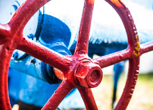 Red Valve On The Blue Pipe.