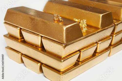Hundreds kilos of illegal gold bullions on background Canvas Print
