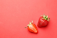 Ripe Juicy Strawberries On A Red Background. Pattern. Creative Summer Background Composition With Strawberry. Minimal Fruit Concept.